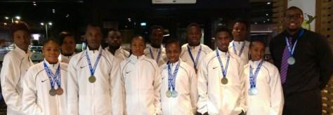 Taekwondo Team to the 2014 Commonwealth Taekwondo Games [L-R: Judith Usifoh, Adaeze Asigbe, Chiamaka Onumonu, Shola Olowookere, Sunday Onofe, Chinazum Nwosu, Jamilu Mohammed, Josephine Esuku, Shola Olushola, Adamu Abubakar Isah, Ebere Blessing Nwakanma and Team Captain & Athlete-Coach, Chika Chukwumerije]. Uche Chukwumerije and Murtala Mohammed are not in the picture